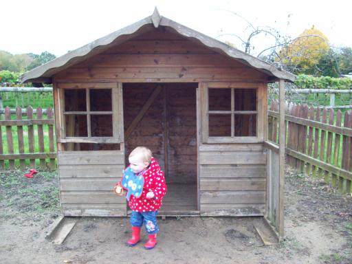 Mary exploring the wendy house at Primrose Vale Farm shop