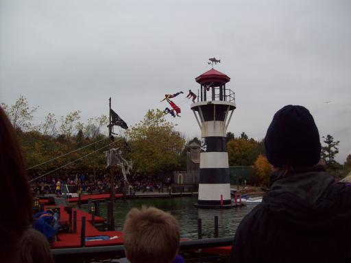 Those are real stunt actors jumping from the lighthouse at LegoLand