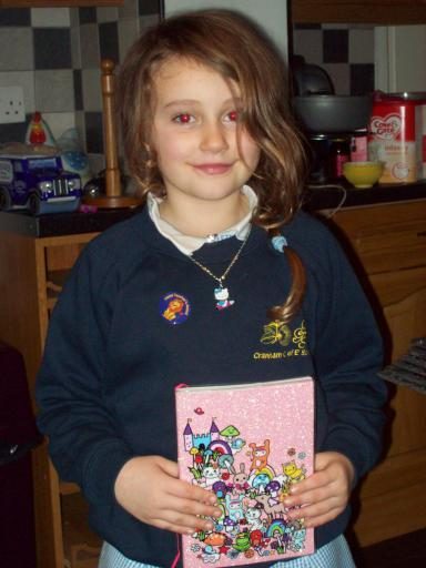 Jean aged 7 with her nanowrimo note book, Hello Kitty Necklace and head masters award sticker!