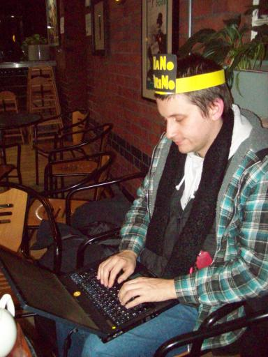 Still trying to finish his NaNoWriMo novel Alaric at the finishing party