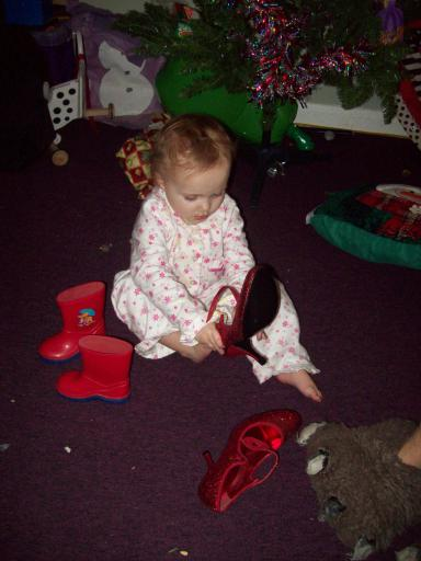 Baby Mary has stolen Mummy's shiny shoes