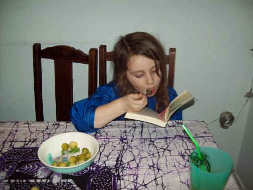 Jeany eating sprouts and peas whilst reading on Boxing Day