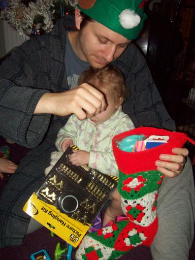 Mary helping Daddy with his stocking