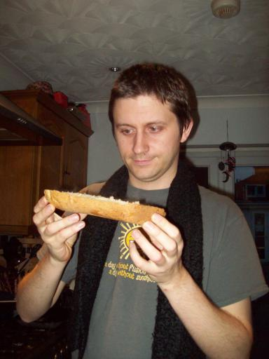 Alaric about to eat the freshly made bread