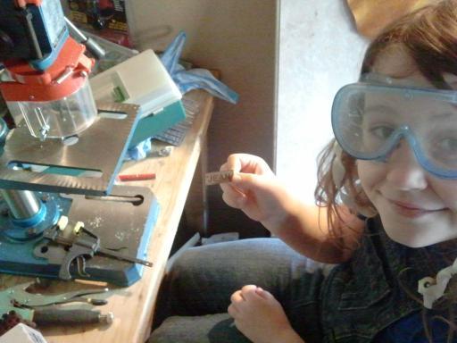 Jean drilling her laser-cut nametag
