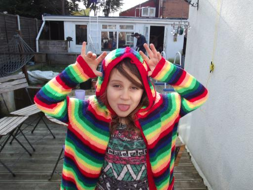 Cheeky Jean in her almost finished rainbow jacket