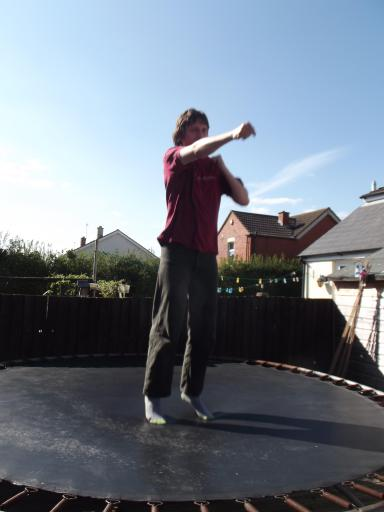 Alaric practicing Krav Maga on the trampoline