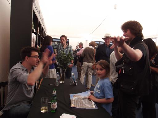Alaric and Lewis Dartnell excitedly talking spaceship design at the Cheltenham Science Festival