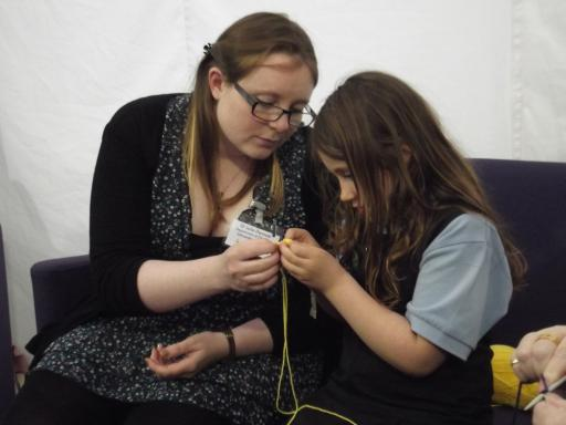 Jeany attempting to crochet an atom at Cheltenham Science Festival