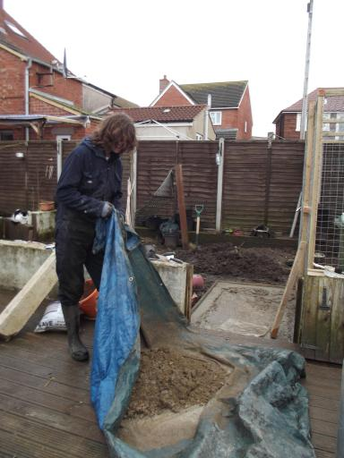 Alaric mixing concrete fro the path to the chicken run