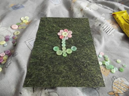Laying out buttons for spring upcycling picture