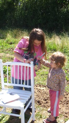 Jean and Mary decorating the allotment chair