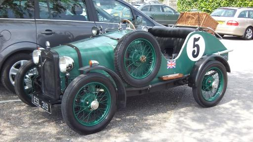 vintage green sports car number 5