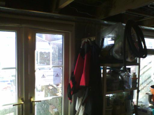 Protective clothing hanging by the door