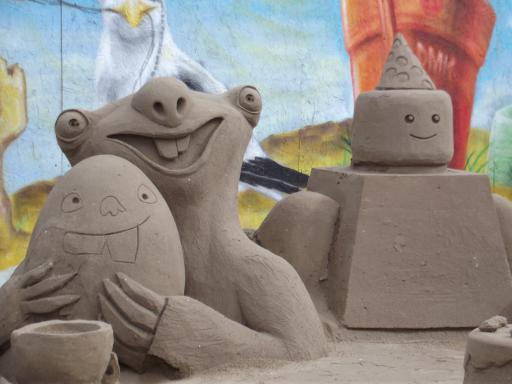 Lego and Sid and the dino egg in sand