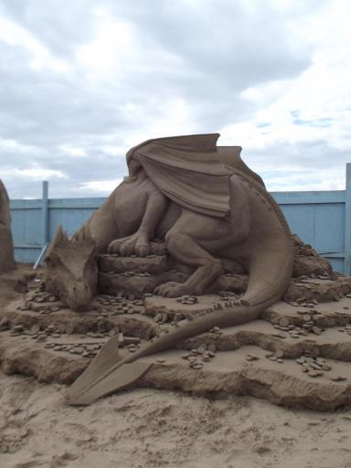 Sand dragon on a bed of sand gold