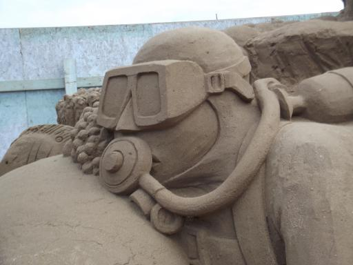 The Diver in sand