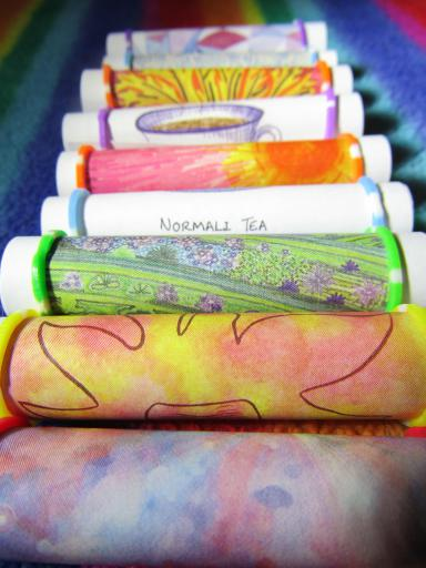 Illustrated poetry notelets turned into poetry scrolls by Sarah Snell-Pym