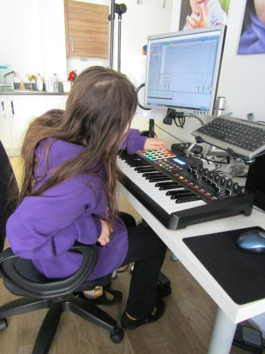 Jean playing with an epic synth keyboard set up