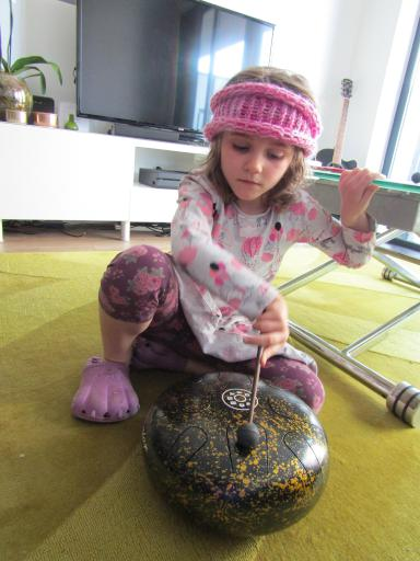 Mary playing with a tank drum from Bali