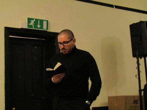 Ziggy reading at Villanelles in Gloucester