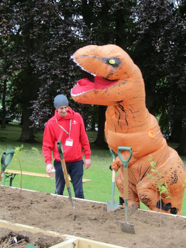 Glos GeoTrust T-rex planting a tree in the wildlife zone Country File Live