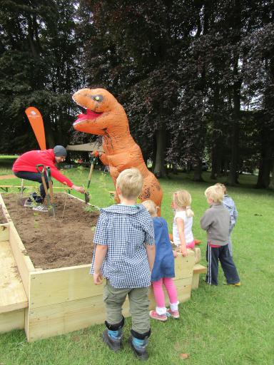 T-rex planting a tree vexed by little tiny t-rex arms Country File Live