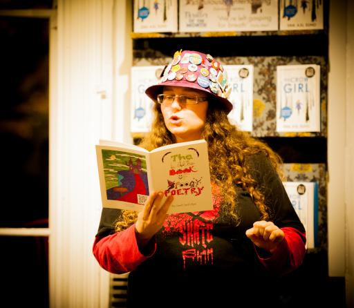 Sarah reading The Little Book of Spoogy Poetry at Waterstones Cheltenham
