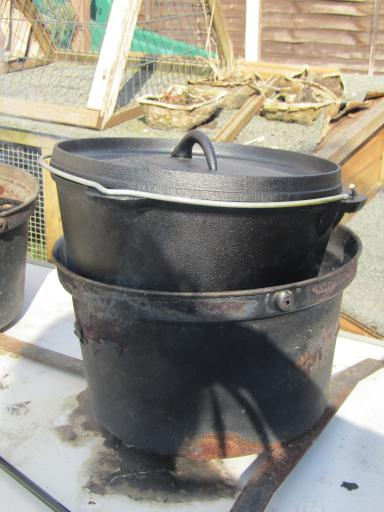 dutch oven in bucket BBQ