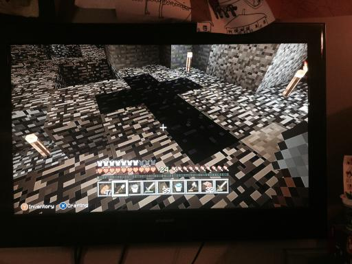 Obsidian cross in the bed rock Minecraft